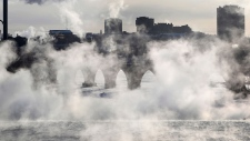 Water vapor rises above St. Anthony Falls on the Mississippi River as the Stone Arch Bridge is obscured, seen from the Third Ave. Bridge Tuesday, Jan. 29, 2019, In Minneapolis. Extreme cold and record-breaking temperatures are crawling into parts of the Midwest after a powerful snowstorm pounded the region, and forecasters warn that the frigid weather could be life-threatening. (David Joles/Star Tribune via AP)