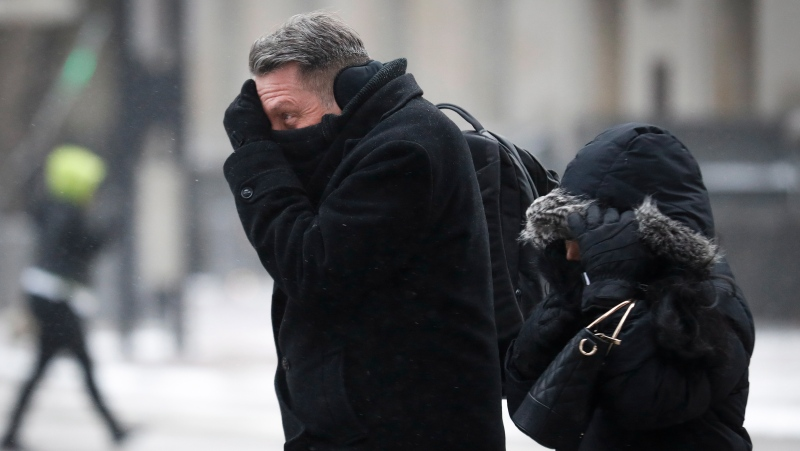 Commuters braves the wind and snow in frigid weather, Wednesday, Jan. 30, 2019, in Cincinnati. The extreme cold and record-breaking temperatures are crawling into a swath of states spanning from North Dakota to Missouri and into Ohio after a powerful snowstorm pounded the region earlier this week. (AP Photo/John Minchillo)