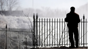 A man looks over icy conditions in this file photo. (AP Photo/Julio Cortez)