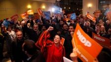 Supporters celebrate candidate Shiela Malcolmson