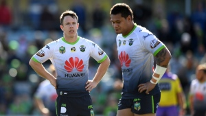 In this Aug. 12, 2018, photo, Canberra Raiders' Sam Williams, left, and Joey Leilua react during a Round 22 NRL rugby match between the Canberra Raiders and the Wests Tigers at GIO Stadium in Canberra, Australia. (Lukas Coch/AAP Images via AP)
