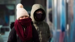 People walk in Chinatown during a cold and windy day in Toronto on Thursday, January 10, 2019. The city declared an extreme cold alert. THE CANADIAN PRESS/Nathan Denette