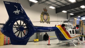 The BC RCMP's Air Services Unit unveiled its new 'Air 5' twin-engine helicopter, with the call sign 'C-FDJB.' The chopper is a tribute to Civilian Member Dave John Brolin, who died as a result of a helicopter accident in the previous Air 5 while training with the Emergency Response Team in 2012 near Chilliwack. (Photos by CTV Vancouver's Pete Cline)