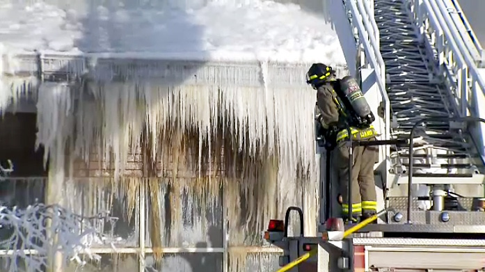 Firefighters work through bitter cold conditions to fully extinguish a fire that broke out at the Agincourt Recreation Centre.