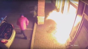 York Regional Police have shared surveillance video showing a suspect setting fire to a store in Vaughan. (YRP)