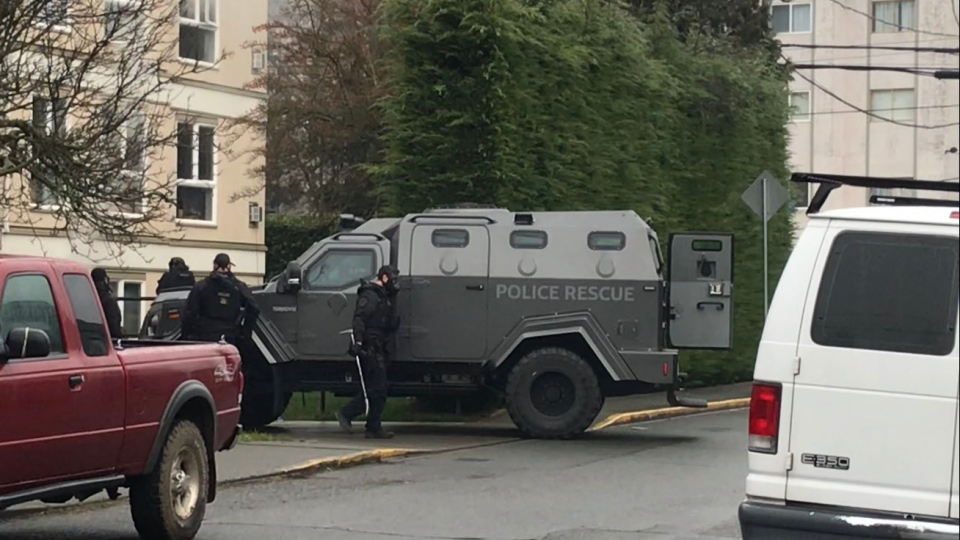 Police shut down the intersection of Burnside Avenue and Carroll Street after arriving in an armoured vehicle on Feb. 1, 2019. (CTV Vancouver Island)