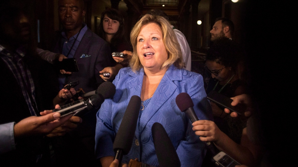 Lisa Thompson, Ontario's Minister of Education scrums with reporters following Question Period, at the Queens Park Legislature, in Toronto on Thursday, August 9, 2018. (THE CANADIAN PRESS/Chris Young)