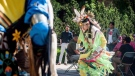 A dancer performs a ceremonial dance at a flag raising ceremony to honour Indian residential school and Sixties Scoop survivors in Saskatoon, Sask., Tuesday, May 29, 2018. (THE CANADIAN PRESS/Matthew Smith)