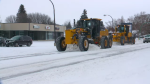 City crews continue to work to clear roads following a major snowfall.