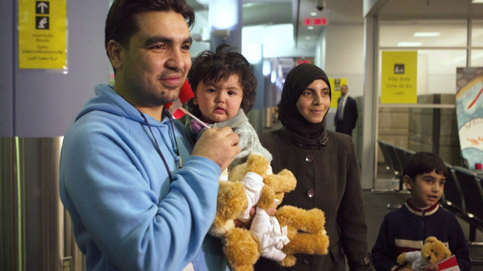 In this file photo from Dec. 18, 2015, a family of Syrian refugees arrives at the Welcome Centre at Toronto's Pearson Airport. (THE CANADIAN PRESS / Chris Young)
