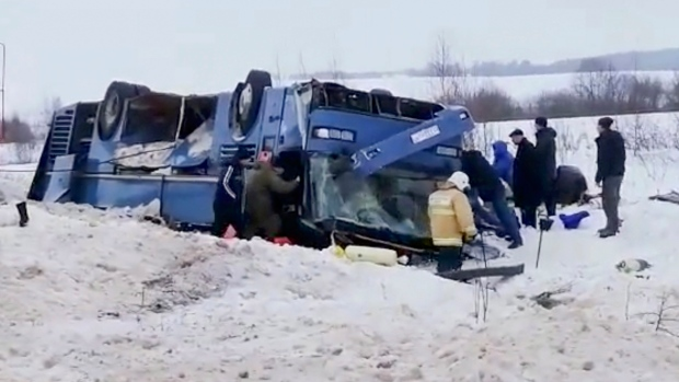 In this Russian Emergency Situations Ministry frame grab, made available on Sunday, Feb. 3, 2019, Emergency Situation employees work at the scene of an accident in the Kaluga region, on a local road about 190 kilometers south of Moscow, Russia. (Russian Ministry for Emergency Situations photo via AP)