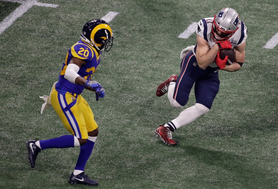 New England Patriots' Julian Edelman (11) runs against Los Angeles Rams' Lamarcus Joyner (20) during the second half of the NFL Super Bowl 53 football game Sunday, Feb. 3, 2019, in Atlanta. (AP Photo/Charlie Riedel)