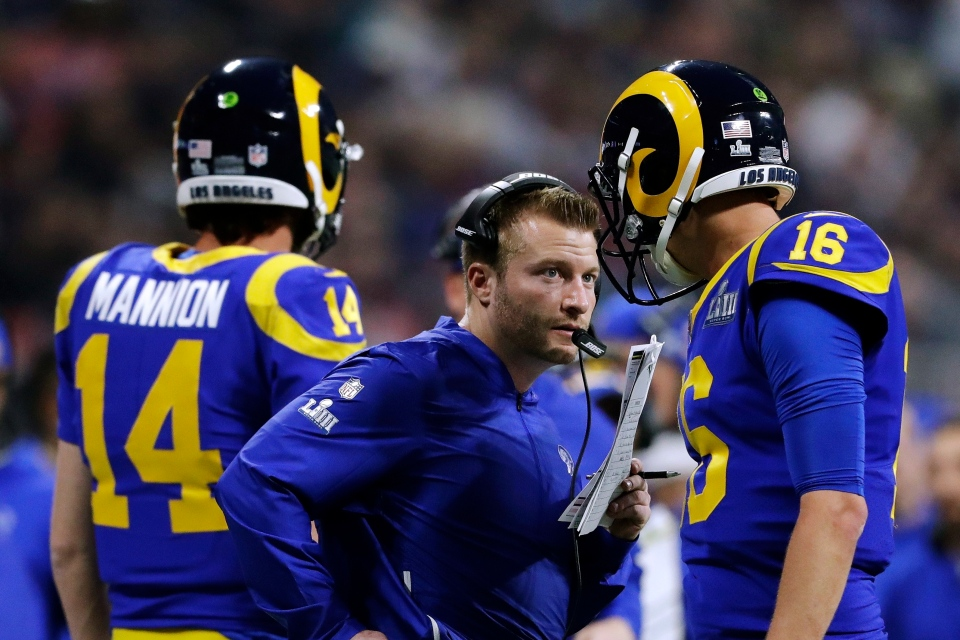 Los Angeles Rams head coach Sean McVay, center, speaks to Jared Goff (16) on the sideline during the second half of the NFL Super Bowl 53 football game against the New England Patriots, Sunday, Feb. 3, 2019, in Atlanta. (AP Photo/John Bazemore)