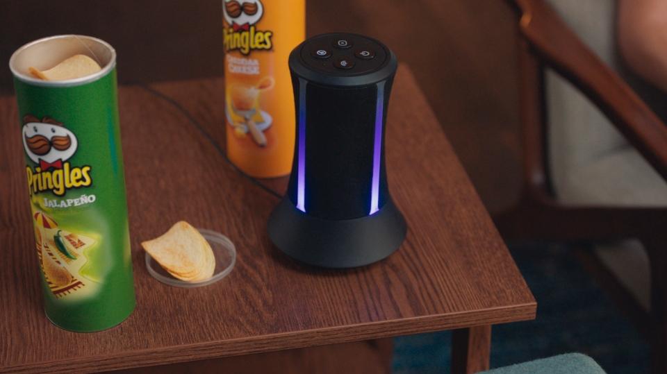 This undated image provided by Grey Group New York shows the Kellogg Company's 2019 Super Bowl NFL football spot for Pringles. In the ad for Pringles, a smart speaker laments not being able to taste Pringles. (Pringles via AP)