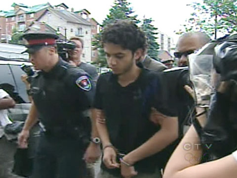 The brother of the three teens killed in Kingston, Ont., Hamed Mohammad-Shafia, is escorted to a Kingston court by police on Thursday, July 23, 2009.