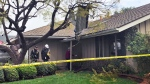 Catherine Paulson, 78, leads investigators to her Yorba Linda, Calif., home that has a piece of aircraft wreckage piercing the roof Monday, Feb. 4, 2019. (AP / Amy Taxin)