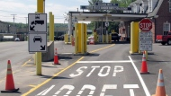 This Aug. 2, 2017 file photo shows the U.S. border crossing post at the Canadian border between Vermont and Quebec, Canada, at Beecher Falls, Vt. (AP Photo/Wilson Ring)