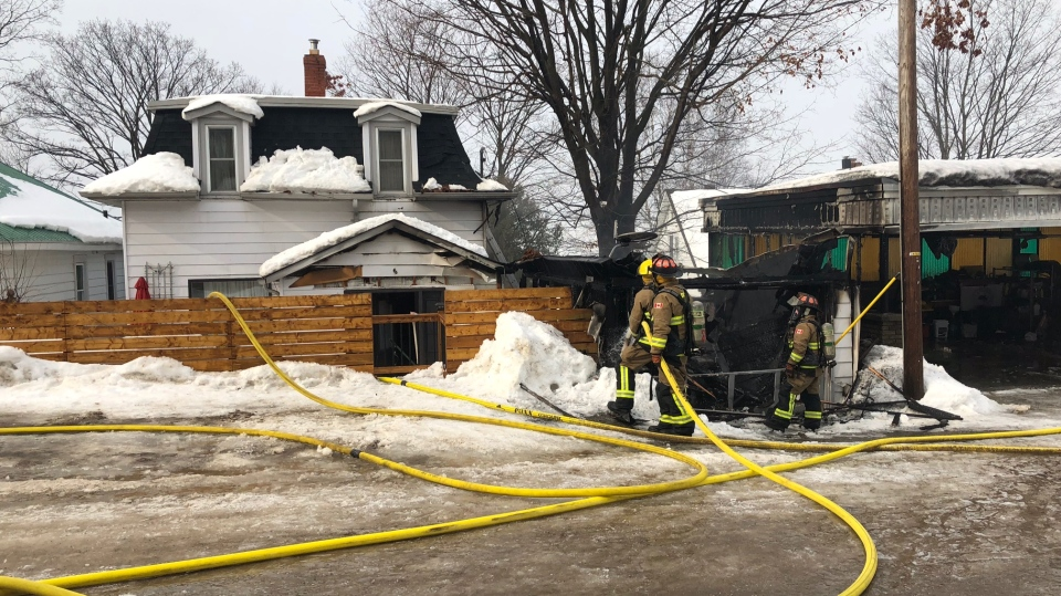 Fire crews quickly extinguish a garage fire that damaged two homes in Penetanguishene on Mon., Feb. 4, 2019 (CTV News/Mike Walker)