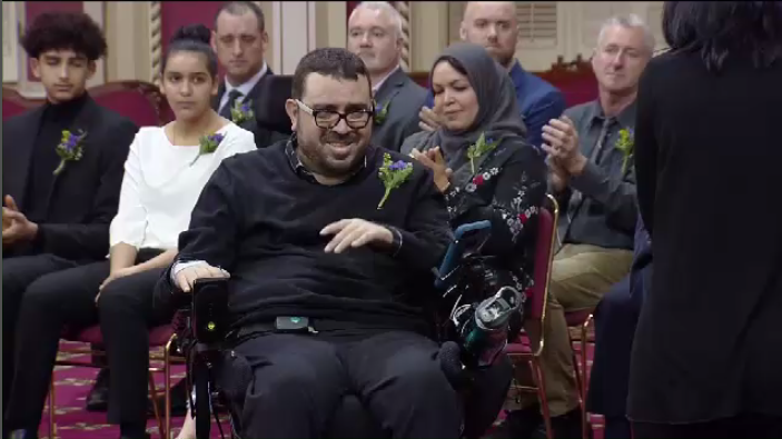 Aymen Derbali, who was hit by seven bullets, put himself in the line of fire in an effort to distract the shooter. He was paralyzed from the waist down and now uses a wheelchair. (CTV Montreal)