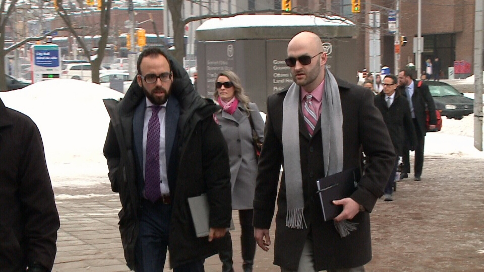 Cst. Daniel Montsion (far right) walks into court.