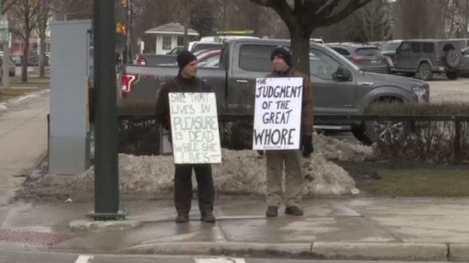 'Street preachers' Matthew Carapella and Steven Ravbar stand on a downtown corner in London, Ont. on Monday, Feb. 4, 2019. (Bryan Bicknell / CTV London)