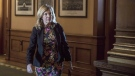 Ontario's Health Minister Christine Elliot walks a corridor in the Queens Park Legislature in Toronto, on Tuesday October 30, 2018. THE CANADIAN PRESS/Chris Young