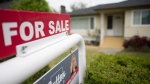 A real estate sign is pictured in Vancouver, B.C., Tuesday, June 12, 2018. (Jonathan Hayward/The Canadian Press)