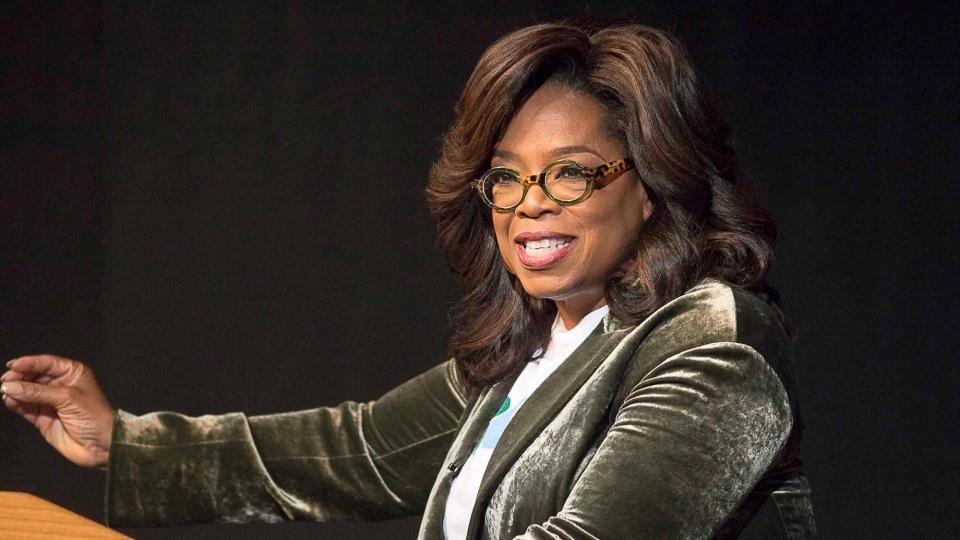 Oprah Winfrey speaks to a crowd during a town hall conversation for gubernatorial candidate Stacey Abrams at the Cobb Civic Center's Jennie T. Anderson Theatre in Marietta, Ga., Thursday, Nov. 1, 2018. (Alyssa Pointer /Atlanta Journal-Constitution via AP)