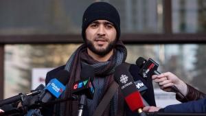Omar Khadr speaks outside court in Edmonton on Thursday, December 13, 2018. (THE CANADIAN PRESS/Jason Franson)