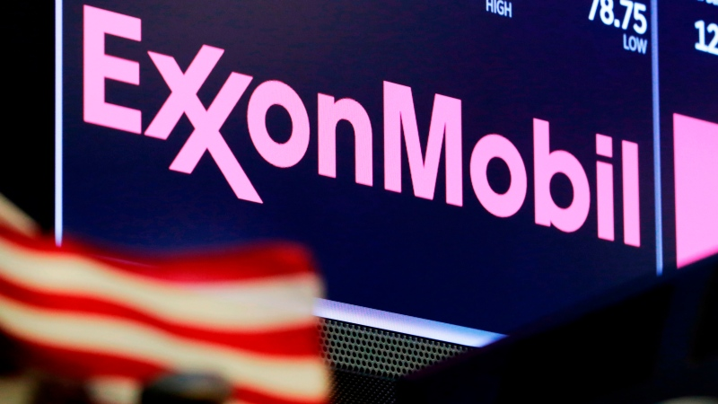 FILE - In this April 23, 2018, file photo, the logo for ExxonMobil appears above a trading post on the floor of the New York Stock Exchange. (AP Photo/Richard Drew, File)