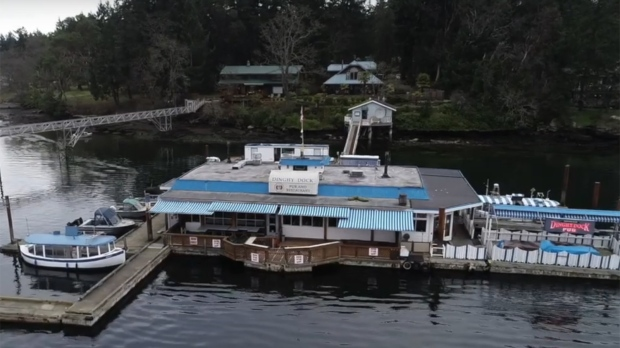 The Dingy Dock Pub on Nanaimo's Protection Island, said to be Canada's only registered floating pub, is up for sale. (YouTube)