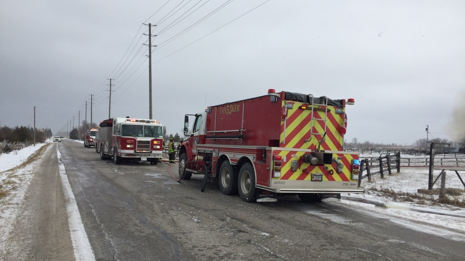 Fire trucks line the 33-34 Sideroad of Nottawasaga on Tuesday, Feb. 5, 2019 (CTV News/Steve Mansbridge)
