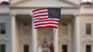 In this Sept. 2017 file photo, a flag is waved during an immigration rally outside the White House, in Washington. (AP Photo/Carolyn Kaster)