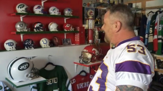 Besides 70 different NFL jerseys, a collection of mini helmets also fill the shelves on the walls of the room in Kenn Thompson's basement