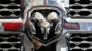 FILE- This Feb. 11, 2016, file photo shows the grill of a Ram 3500 Heavy Duty Turbo Diesel truck at the Pittsburgh International Auto Show in Pittsburgh. (AP Photo/Gene J. Puskar, File)