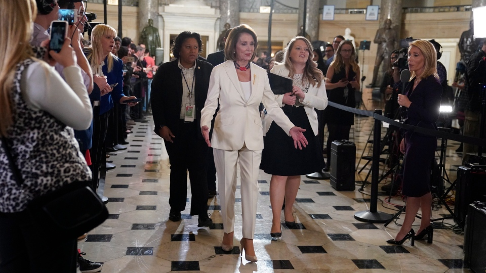U.S. House Speaker Nancy Pelosi of Calif, arrives to listen to U.S. President Donald Trump deliver his State of the Union address to a joint session of Congress on Capitol Hill in Washington, Tuesday, Feb. 5, 2019. (AP Photo/Carolyn Kaster)