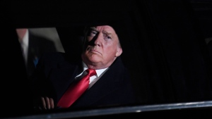 U.S. President Donald Trump sits in his car at the White House in Washington as he heads to Capitol Hill to deliver his State of the Union address, Tuesday, Feb. 5, 2019. (AP Photo/Susan Walsh)