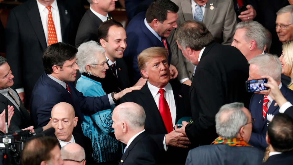 U.S. President Donald Trump arrives to deliver his State of the Union address to a joint session of Congress on Capitol Hill in Washington, Tuesday, Feb. 5, 2019. (AP Photo/J. Scott Applewhite)