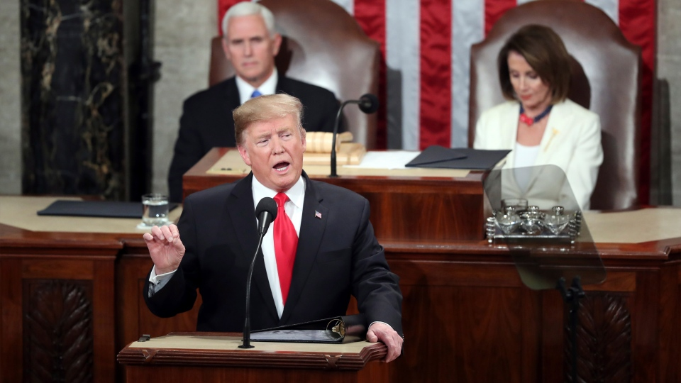 U.S. President Donald Trump delivers his State of the Union address to a joint session of Congress on Capitol Hill in Washington, as Vice President Mike Pence and Speaker of the House Nancy Pelosi, D-Calif., watch, Tuesday, Feb. 5, 2019. (AP Photo/Andrew Harnik)