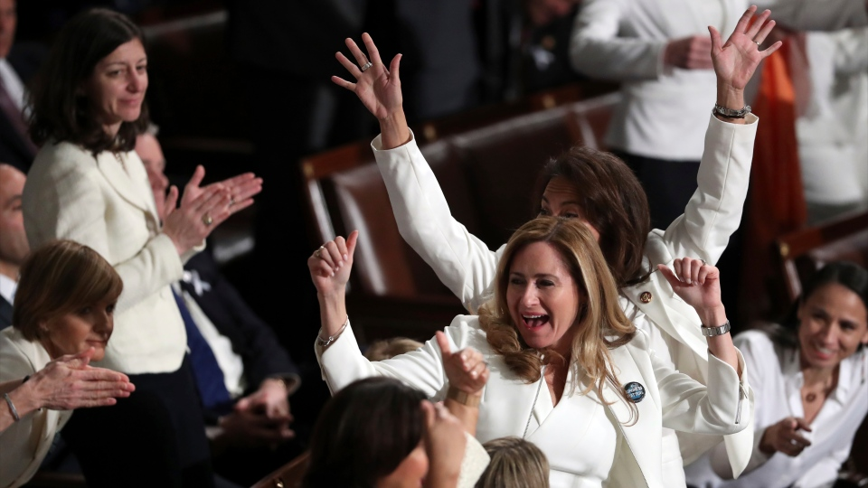 Members of Congress cheer after U.S. President Donald Trump acknowledges more women in Congress during his State of the Union address to a joint session of Congress on Capitol Hill in Washington, Tuesday, Feb. 5, 2019. (AP Photo/Andrew Harnik)