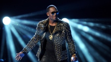 In this June 30, 2013 file photo, R. Kelly performs at the BET Awards at the Nokia Theatre in Los Angeles. (Photo by Frank Micelotta/Invision/AP, File)