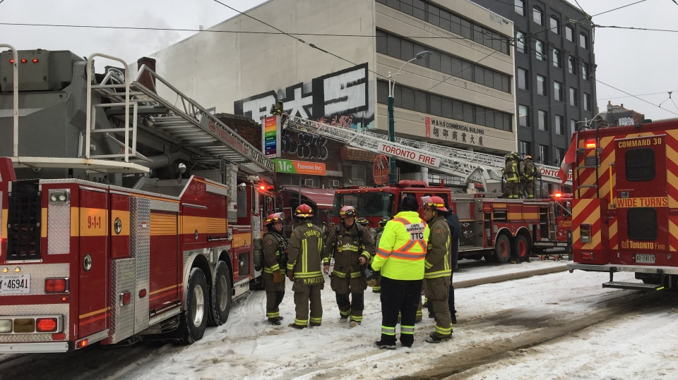 Toronto firefighters at the scene of a three-alarm blaze in Chinatown on January 6, 2019.
