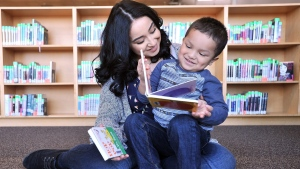 Alma Villa, 18, read to her son Ulysses Villa, 3, at North Medford High School on Jan. 7, 2016. The school is working creating a children's library for its teen parent program.(Jamie Lusch/The Medford Mail Tribune via AP)