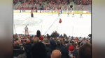 Oilers fan tosses jersey onto ice during Tuesday's game.