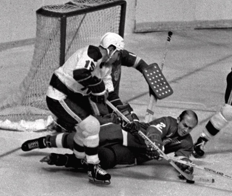 Detroit Red Wings defenceman Gary Bergman (2) dives in front of a shot by Minnesota North Stars' Andre Boudrias (15) in front of goalie Roger Crozier in this Nov. 7, 1968 file photo in Detroit. THE CANADIAN PRESS/A