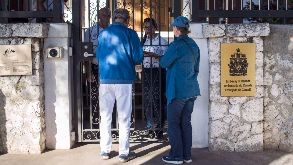 Visitors wait at the entrance of Canada's embassy in Havana, Cuba, on April 17, 2018. (THE CANADIAN PRESS/AP, Desmond Boylan)