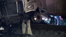 A tractor trailer pushed over a median