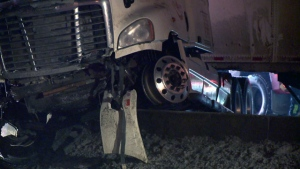 A tractor trailer was pushed over the median during a multi-vehicle crash on Highway 20 East near Riviere Beaudette, Quebec, on Feb. 6, 2019 (CTV Montreal/Cosmo Santamaria)