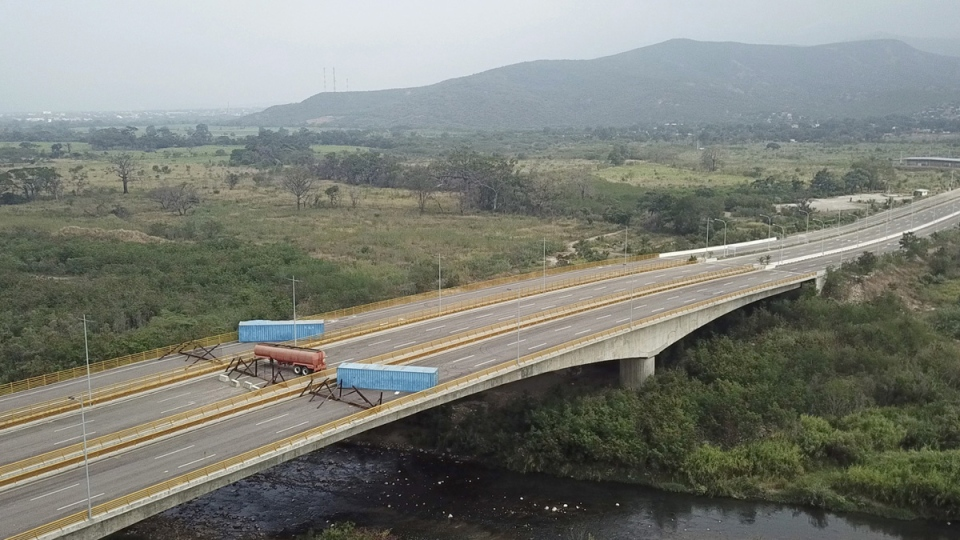 Barricade on the Tienditas International Bridge, as seen from the outskirts of Cucuta, on Colombia's border with Venezuela, Feb. 6, 2019. (AP)