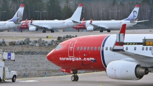 This Thursday March 5, 2015 file photo shows parked Boeing 737-800 aircrafts belonging to budget carrier Norwegian at Stockholm Arlanda Airport. (Johan Nilsson/TT via AP, File)